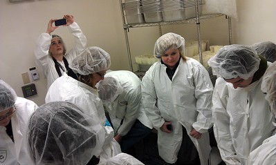 Tweeps dress in cleanroom protective clothing before viewing the National Meteorite Collection