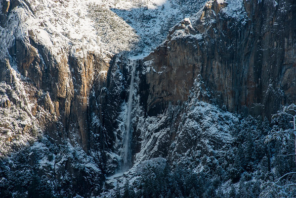 Bridalveil falls surrounded by snow