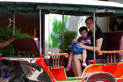 """An An and TK on a """"Took Took"""", a popular mode of transportation around Phnom Penh"""