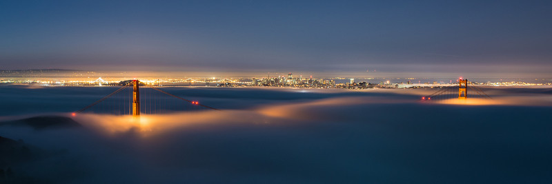 Pano cropping of the sweet fog. I love the city lights in the background