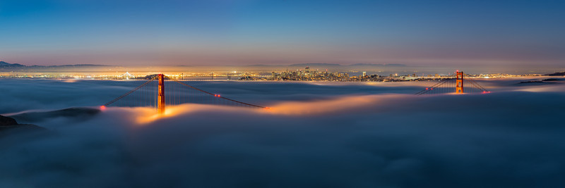 This is a 70 megapixel pano of the low fog over the golden gate bridge. The sun is just starting to come up, bringing the blue hour some subtle pink and reds along the horizon. I stitched 6 photos together for this panorama.