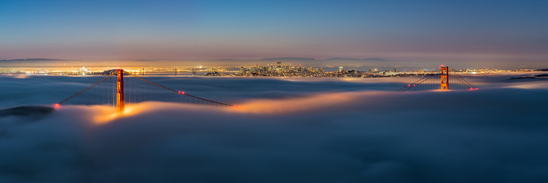 Slightly closer cropping of the previous panorama.  This is a 70 megapixel pano of the low fog over the golden gate bridge. The sun is just starting to come up, bringing the blue hour some subtle pink and reds along the horizon. I stitched 6 photos together for this panorama.