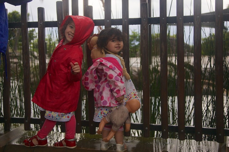 Raiyanne, Tasneem, and Baby each displays a different attitude to the falling rain.