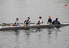 Boys V4: Andre, Evan, Liam, Will, and Benjamin (cox) rowing down to the start