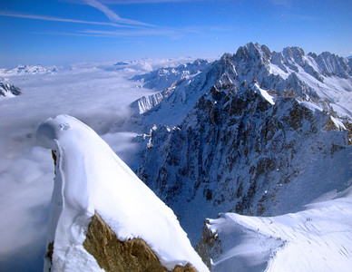And here is the Chamonix valley again, covered in cloud. Bottom right are skiers who've just survived the NE ridge, preparing to start their Vallee Blanche descent.