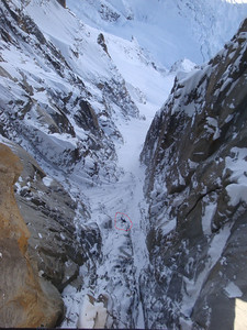 The view here straight down from the bridge - which is usually battered by icy winds - is truly terrifying. But perhaps not for some. Some apparently superhuman climbers (circled) are actually attempting to climb up the gully beneath...!