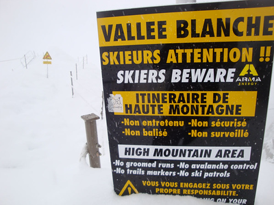 The last chance to turn back. Beyond here helicopter rescue is the only way out. The Vallee Blanche is 17 km long, with a vertical descent of 2,800 m - the biggest descent of any major off-piste route in Europe.