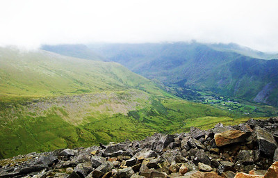 Finally I staggered to the top of Elidir Fawr here - the first summit of the second (Glyderrau) mountain range. The first range - the Snowdon Massif - is opposite (the views were destroyed by the clouds). In the valley is the tiny hamlet of Nant Peris and the first check point. Like most others, this summit was covered in rock made super slick from the rain. Apparently not even trail shoes could grip it, and I had only running shoes... Kate of course was long gone.