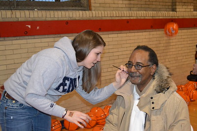 Ray Jones W'70 gets some Penn spirit from Liz, Eng'15!