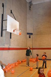 Shooting hoops.
