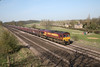 29 March 2012 :: 66156 at Knabbs Bridge, New Barnetby with 4R34, Drax to Immingham empty coal.  Note the smaller numerals on the side of the locomotive