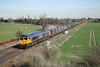 27 March 2012 :: 66735 passes Eggborough power station with Gypsum wagons from Drax