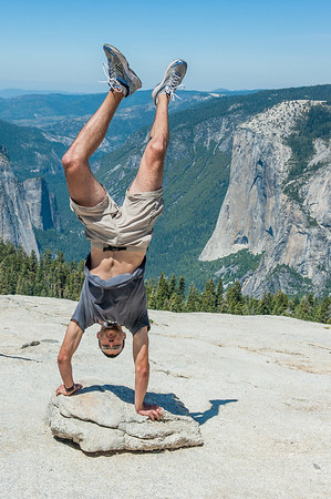 Sam's doing a handstand at Sentinal Dome with El Capitan in the background