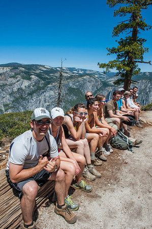 We found a tree to sit on and lined up for a group shot. You can just make out Yosemite Falls behind Jared's back