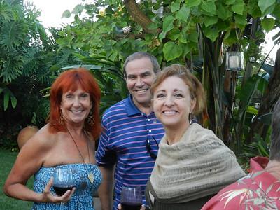Deb Arnold, Walt Zipperman and Sharon Grandinette enjoying a glass of wine.
