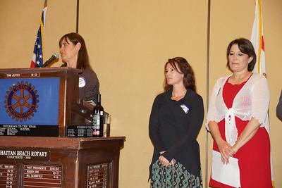 Robinson's Principal Nancy Doyle presents Robinson's Teacher of the Year Award to Erica Yerke.