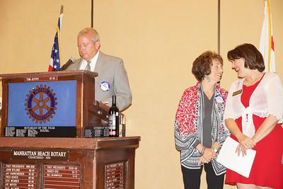 MBMS Principal John Jackson presents the MBMS's Teacher of the Year Award to Doris Giambra.