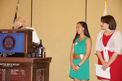 Meadows Principal Connie Harrington presenting Meadows Teacher of the Year Award to Michelle Legaspi.