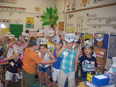 Students in Mrs. Dooley's Kindergarten class wearing their 'Chester' head bands and giving the sign for I LOVE YOU.  Students read The Kissing Hand  and compared their feelings about the first day of Kindergarten  to Chester's feelings about going to school.