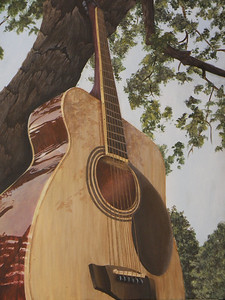 "Best of Show - Senior Emily Rives' painting of a guitar against a tree called ""Reaching for Heaven"""