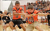 Juniors Devin Shockley and Jacob Gilliam yank the rope to try to win the Tug-A-War class competition on Aug 30 at Bonfire.