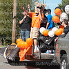"As the cougar, senior Marcus McNeace waves from the Senior Float during the Homecoming Parade on Sept. 22 on 67th Street. The theme for the senior float was ""Cougar Idol""."