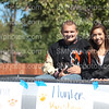 Seniors Hunter Bruders and Giovana Silva smile during the Homecoming Parade on Sept. 22.