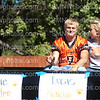 Senior Lucas Karlin waves during the Homecoming Parade on Sept. 22.
