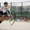 Junior Travis Calvin races to the ball aginst Olathe East on April 1. Calvin won the match,