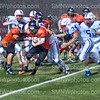 Senior Kelby Quint fights off a tackle from an Olathe North player at SMS on Aug. 31. Cougars won 25-14.