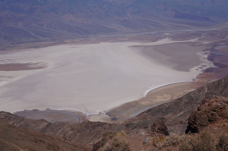 """Badwater, a basin located in Death Valley, is the specific location (36° 15' N 116° 49.5' W) of the lowest elevation in North America at 282 feet below sea level. This point is only 84.6 miles ESE of Mount Whitney, the highest point in the contiguous United States with an elevation of 14,505 feet. Death Valley holds the record for the highest reliably reported temperature in the Western hemisphere, 134 °F at Furnace Creek on July 10, 1913 just short of the world record, 136 °F in 'Aziziya, Libya, on September 13, 1922."" - <br /> <br /> <a href=""http://en.wikipedia.org/wiki/Death_Valley"">http://en.wikipedia.org/wiki/Death_Valley</a><br /> <br /> <br /> This is the view of Badwater Basin from Dante's View, one of the scenic overlooks in the park. It's hard to appreciate the size of the basin, but to put it into some perspective, this photo from Dante's View was taken over 5,000 feet higher in elevation than the salt flats below (almost a mile higher!). From this overlook on a clear day, you can see not only the lowest point in North America, but also the highest point in the lower 48 (Mt Whitney) at 14,505 feet."
