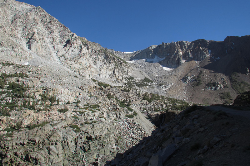 Tioga Pass Road in the shadows on the right side of the photo.