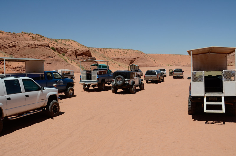 Near the entrence, where all the tour vehicles parked.
