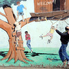 Mapleton Elementary Feature39.JPG Baker Hahn, 8, plays in front of the mural at the old Mapleton Elementary School  playground on Sunday, February 19, 2012.<br /> Cliff Grassmick / February 19, 2012