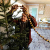 "Wise Homestead Christmas59.JPG Alan  Wise decorates a Christmas tree in a traditional manner in his family's 1870's homestead on Jasper Road in Erie.<br /> The Wise Homestead Museum in Erie is hosting a ""Homestead Christmas"", on Saturday, December 15th, 2012.<br />  For a video and more photos of the homestead, go to  <a href=""http://www.dailycamera.com"">http://www.dailycamera.com</a>.<br /> Cliff Grassmick  / December 7, 2012"