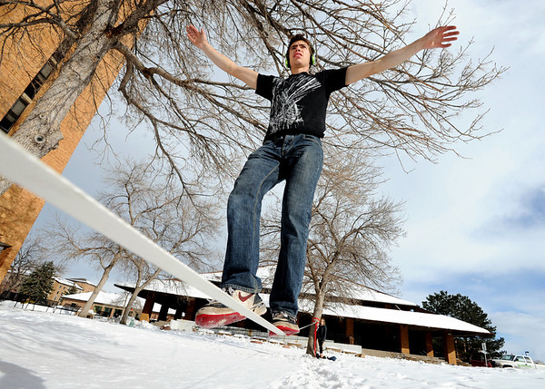 CU Slacking119.JPG Andrey Shprigel, a CU student, takes some time to do some slacklining at Williams Village on Thursday afternoon.<br /> Cliff Grassmick / February 9, 2012