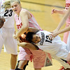 "Colorado Utah NCAA Women96.JPG Taryn Wicijowski, left, of Utah, rips the ball from Ashley of Colorado,<br /> during the second half of the February 18, 2012 game in Boulder.<br /> For more photos of the game, go to  <a href=""http://www.dailycamera.com"">http://www.dailycamera.com</a>.<br /> February 18, 2012 / Cliff Grassmick"