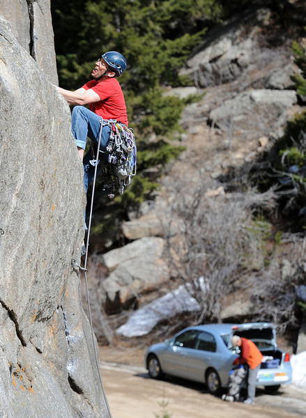 """Climbing Castle Rock in Boulder Canyon56.JPG Adam Brink climbs up one of the routes at Castle Rock Sunday afternoon.<br /> For more than 50 years, no one has done any maintenance to the pullout loop by Castle Rock in Boulder Canyon. That's because land management agencies all thought it was the other guys' problem. Turns out, its Boulder County's problem ( in part), so now the open space department is proposing some upgrades to the area.<br /> For more photos of climbing, go to  <a href=""""http://www.dailycamera.com"""">http://www.dailycamera.com</a>.<br /> Cliff Grassmick / March 18, 2012"""