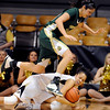 "Colorado CSU Women44.JPG Kara Spotton of CSU, jumps over Arielle Roberson of CU on Wednesday.<br /> For more photos from CU CSU basketball, go to  <a href=""http://www.dailycamera.com"">http://www.dailycamera.com</a>.<br /> Cliff Grassmick / December 5, 2012"