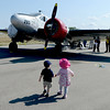 """Hey Kate, Let's take a look at this one.""<br /> Alex Quinonez, left, and Kate Beck, both 2, walk over to one of the vintage airplanes during the 7th annual Boulder Airport Day on Saturday.<br /> <br /> June 16, 2012"