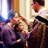 "Ash Wednesday  201229.jpg Ash Wednesday  201229.JPG Father Peter Mussett of the St. Thomas Aquinas Catholic Center, applies ash to Alicia Canney as her son, George watches.<br /> For a video of Ash Wednesday, go to  <a href=""http://www.dailycamera.com"">http://www.dailycamera.com</a>.<br /> Cliff Grassmick / February 22, 2012"