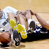 Xavier Johnson, left, of Colorado, and Ben Olayinka of Northern Arizona, go to the floor during the second half of the December 21, 2012 game in Boulder.<br /> Cliff Grassmick / December 21, 2012