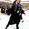 "Ashley Basta is jumping for joy while talking to her family on the phone during CU graduation on Friday.<br /> The ceremony will honor candidates for 6,237 degrees, including 4,830 bachelor's degrees, 994 master's degrees, 162 law degrees and 251 doctoral degrees for spring and summer.<br /> The number of degree applications for the University of Colorado is the largest in the school's history, and comes four years after the record-setting freshman class of fall 2008. That year, 5,833 freshmen enrolled, exceeding the previous record-setting class of 2006 that enrolled 5,617 freshmen. For more photos and a video, go to  <a href=""http://www.dailycamera.com"">http://www.dailycamera.com</a>.<br /> Cliff Grassmick / May 11, 2012"
