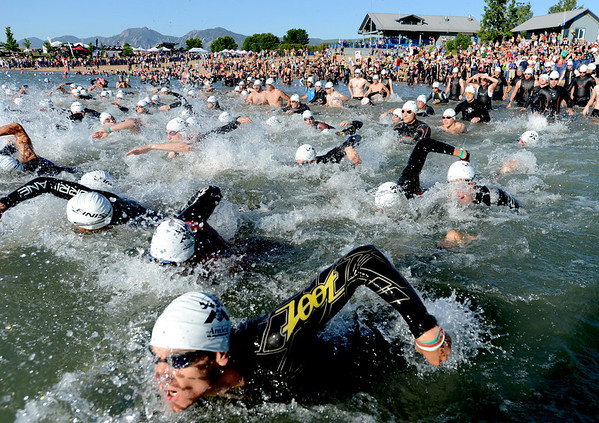 Athletes in the 12-29 age group begin their 2012 Boulder 5430 Sprint Triathlon on Sunday at the Boulder Reservoir. <br /> June 17, 2012