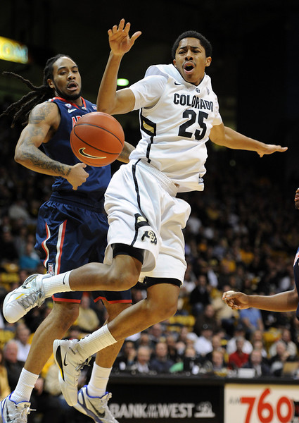 "Colorado Arizona Men61.JPG  Spencer Dinwiddie (25) of Colorado, has the ball knocked away by Jesse Perry, left,  of Arizona during the first half of the January 21, 2012 game in Boulder.<br /> For more photos of the game, go to  <a href=""http://www.dailycamera.com"">http://www.dailycamera.com</a>.<br /> January 21, 2012 / Cliff Grassmick"