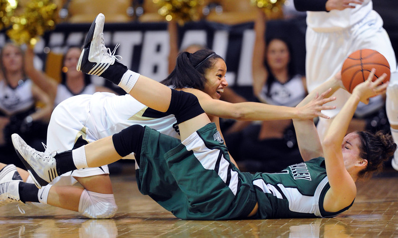 Arielle Roberson, left, of Colorado, tries to get the ball from Sammie Jensen of Utah Valley during the first half of the December 22, 2012 game in Boulder.<br /> Cliff Grassmick / December 22, 2012