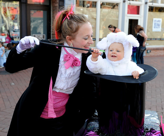 """Munchkin Masquerade Boulder231.JPG Maible Matranga, 1, plays a rabbit in a hat with her mother, Kelly Davidson, left,  playing the magician during the Munchkin Masquerade.<br /> Over 80 downtown businesses provided treats to kids of all ages at the annual Munchkin Masquerade.<br /> For more photos and a video of the Munchkin Masquerade, go to  <a href=""""http://www.dailycamera.com"""">http://www.dailycamera.com</a>.<br /> Cliff Grassmick  / October 31, 2012"""