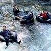 Quayle Hodek, bottom, left, Jake Adams, John Powers, and Lana Malone, travel down Boulder Creek as part of the 5th annual Tube to Work event on June 29, 2012 in Boulder, Colorado.<br /> / June 29, 2012