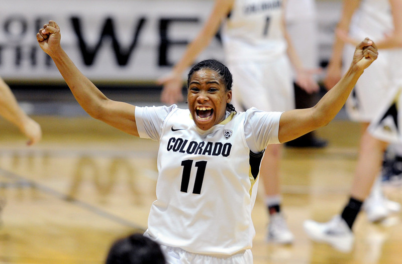 "Colorado Villanova WNIT177.JPG Brittany Wilson of Colorado runs off the court celebrating as the Buffs hold on to beat Villanova 48-47.<br /> For more photos of the game, go to  <a href=""http://www.dailycamera.com"">http://www.dailycamera.com</a>.<br />  Cliff Grassmick / March 22, 2012"