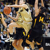 Colorado Arizona State Women126.JPG Lexy Kresl of Colorado, drives between Alex Earl, left, and Adrianne Thomas of Arizona State during the first half of the February 11, 2012 game in Boulder.<br /> <br /> February 11, 2012 / Cliff Grassmick